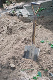 Shovel in soil Stock Image