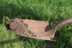 Shovel. A shovel, or spade, holding up dirt above the ground Stock Photos