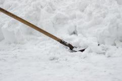 Shovel stuck in bank of snow. At winter snowdrift Stock Photo