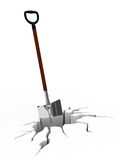 Shovel in surface crack Royalty Free Stock Photo