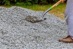 Shovel throw stones into gabione. Throw stones with a shovel stock image