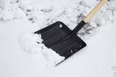 Shovel to clean snow. In the park in nature Royalty Free Stock Images