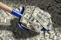 Shovel up money Stock Images