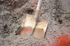 Shovel in Wet Concrete. Shovel stuck in wet concrete for a slab under construction Stock Image