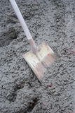 Shovel in Wet Concrete Royalty Free Stock Photo