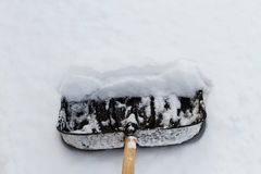 Shovel on the white snow. For cleaning Stock Images