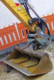 Shovel from a yellow excavator. Rusty shovel from a yellow excavator  filled with water Royalty Free Stock Photography
