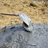 Shoveling mud Stock Photography