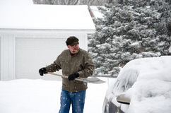 Shoveling out the car Royalty Free Stock Photo