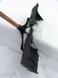 Shoveling Season. Close up of Shovel at work after snowstorm stock photography