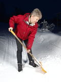 Shoveling snow. Woman shoveling snow after a heavy snowfall Royalty Free Stock Images