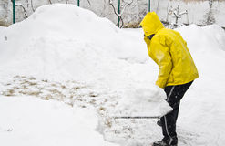 Shoveling snow. Man in winter shoveling a lot of snow Royalty Free Stock Photo