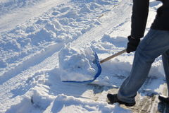 Shoveling snow. After a snow storm Royalty Free Stock Image
