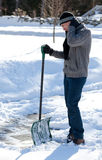 Shoveling SNow Backache. A man shoveling his snow stops to massage his sore neck and back Stock Photography