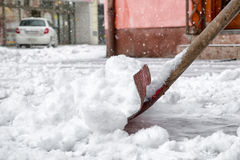 Shoveling snow in city Stock Photos