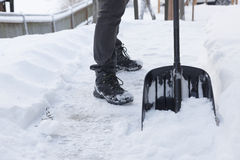 Shoveling snow Stock Images