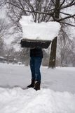 Shoveling Snow Full Load Thrown at Viewer. A shovel full of snow being thrown at the camera Royalty Free Stock Image