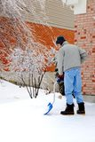 Shoveling Snow After an Ice Storm Royalty Free Stock Photos