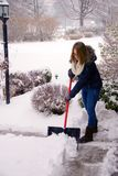 Shoveling Snow Just Getting Started. A young woman shoveling snow during a blizzard Stock Photography