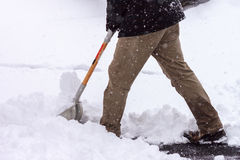 Shoveling Snow. Male shoveling snow during storm in winter in Virginia suburb Stock Photos