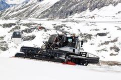 Shoveling snow, Molltaler Glacier, Austria Stock Photography