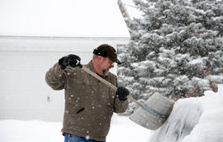 Shoveling snow off the car Royalty Free Stock Image