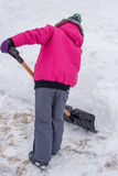 Shoveling Snow. A picture of a young girl shoveling a snow covered drive way during winter in Canada Stock Photos
