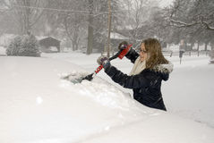 Shoveling Snow Scraping Car Windshield Royalty Free Stock Image