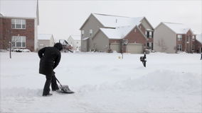Shoveling snow stock video footage