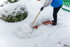 Shoveling snow woman while Royalty Free Stock Photography