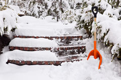 Shoveling the steps Stock Images