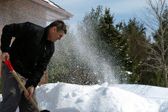 Shovelling can be fun!. Not always backbreaking work, shovelling can be fun if you get into the spirit of it. Digging out from another record snowfall in Central Stock Photography