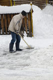 Shovelling the snow Stock Images