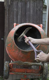 Shovelling in to a cement mixer Stock Photos