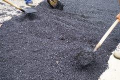 Shovels and asphalt Stock Image