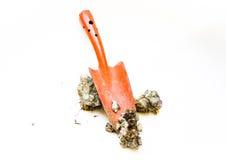 Shovels digging. The red shovels digging soil Royalty Free Stock Photo