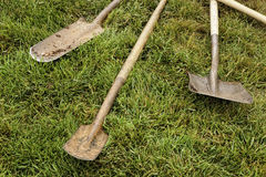 Shovels in Grass Royalty Free Stock Photos