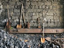 Shovels next to brick wall in coal power plant Stock Image