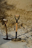 Shovels in the sand. Two shovels in the beach sand Royalty Free Stock Photography