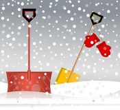 Shovels in the snow mittens storm Royalty Free Stock Photos