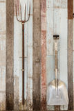 Shovels on vintage wooden wall Royalty Free Stock Image