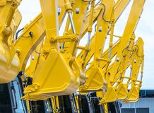 Shovels of yellow backhoe. Close up shovels of yellow backhoe. for use construction building industry stock image