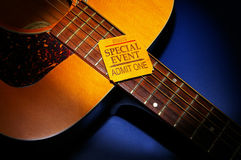The show. Special-Event ticket stub on an acoustic guitar Stock Photo
