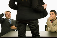 Show. Woman showing her body to two businessman Stock Photos