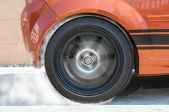 Show burning tires racing car in racetracks. Stock Image