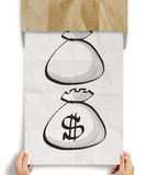 show dollar sign bag out of recycle Royalty Free Stock Image