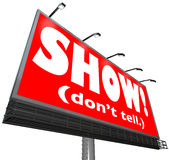 Show Don't Tell Words Billboard Writing Advice Storytelling Tip. The words Show Don't Tell on a red billboard sign to tell writers to be illustrative Stock Image