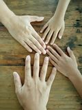Show the family hand on a wooden table. royalty free stock images