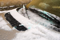 Show and ice on a windscreen. Car windscreen covered in snow and ice royalty free stock image