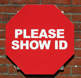 Show ID. A red sign reading Please Show ID royalty free stock photography